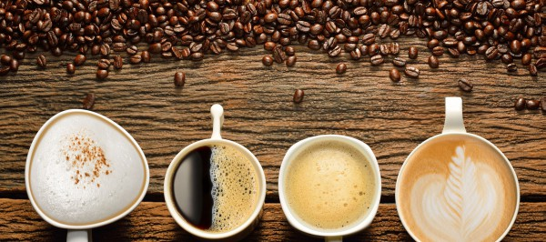 32283962 - variety of cups of coffee and coffee beans on old wooden table